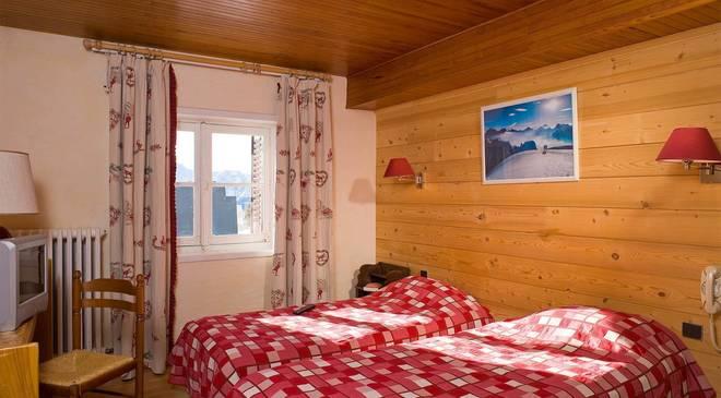H tel le christina alpe d 39 huez madame vacances for Chambre d hotes alpe d huez